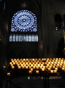 lighting a candle for Joah at Notre Dame