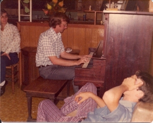 Mr. Jackie McGee playing our piano at our home.