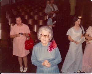 Mrs. Jessie Toney, at the front of the auditorium in which we did our recitals. I'm taking the photo from the stage.