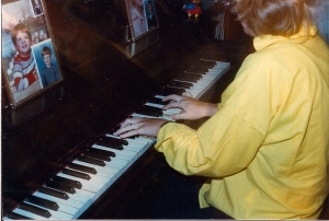 Years later, on a visit home, Mama captured photo-shy me as I played the piano I learned on.